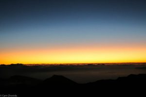 Dawn begins to break over the Haleakalā volcano